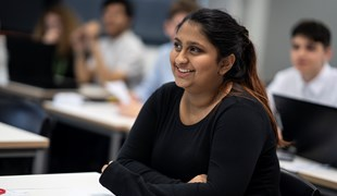 A female student smiles during a lesson at UTC.