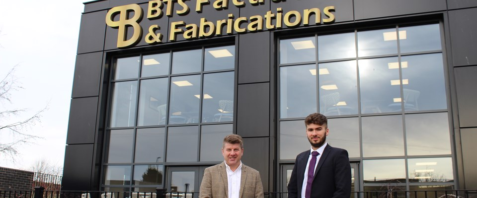 Phil Atkinson and Stephen Henry stand in front of BTS' offices.