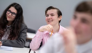 A student smiles whilst in a lesson at UTC.