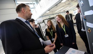 6th Form students presenting project to principle