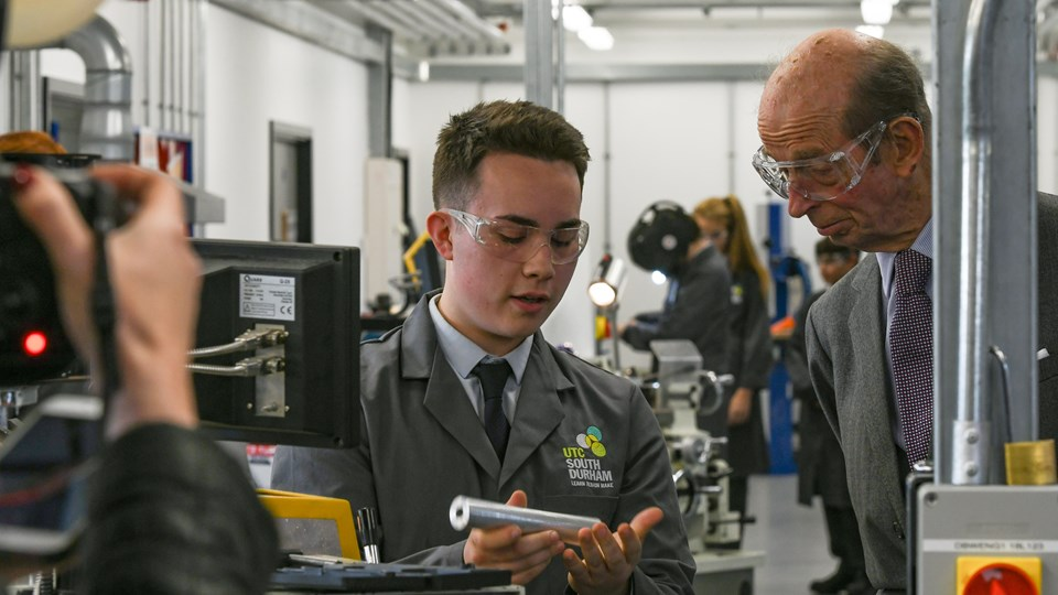 HRH the Duke of Kent talking to one of our students about one of this metal work projects.