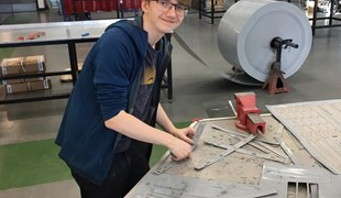 Sixth Form student Tom Shepherd making visors in the engineering hall