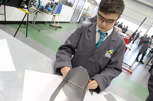 a student manufacturing a tool box