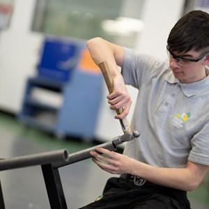 A student carries out some metal work in the engineering hall at UTC South Durham.