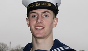James Le Poidevin, UTC alumnus, poses in his Royal Navy uniform.