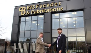 Phil Atkinson and Stephen Henry shake hands in front of BTS' offices.